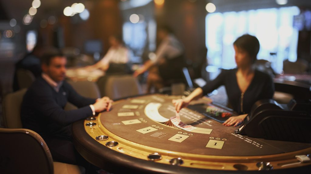 dealer and gambler at a table