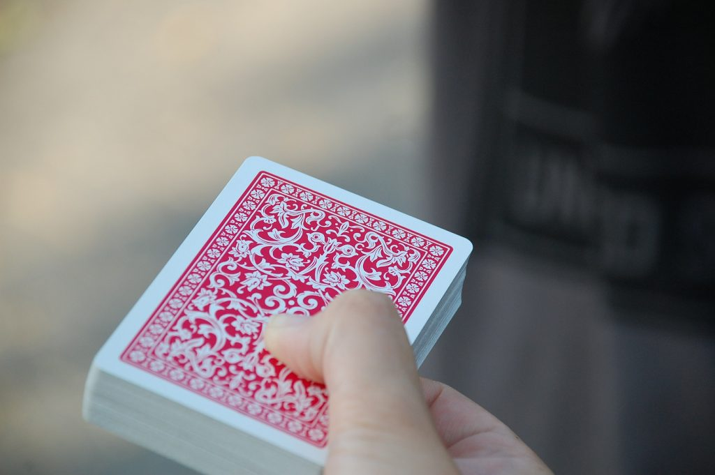 A hand holding a deck of cards