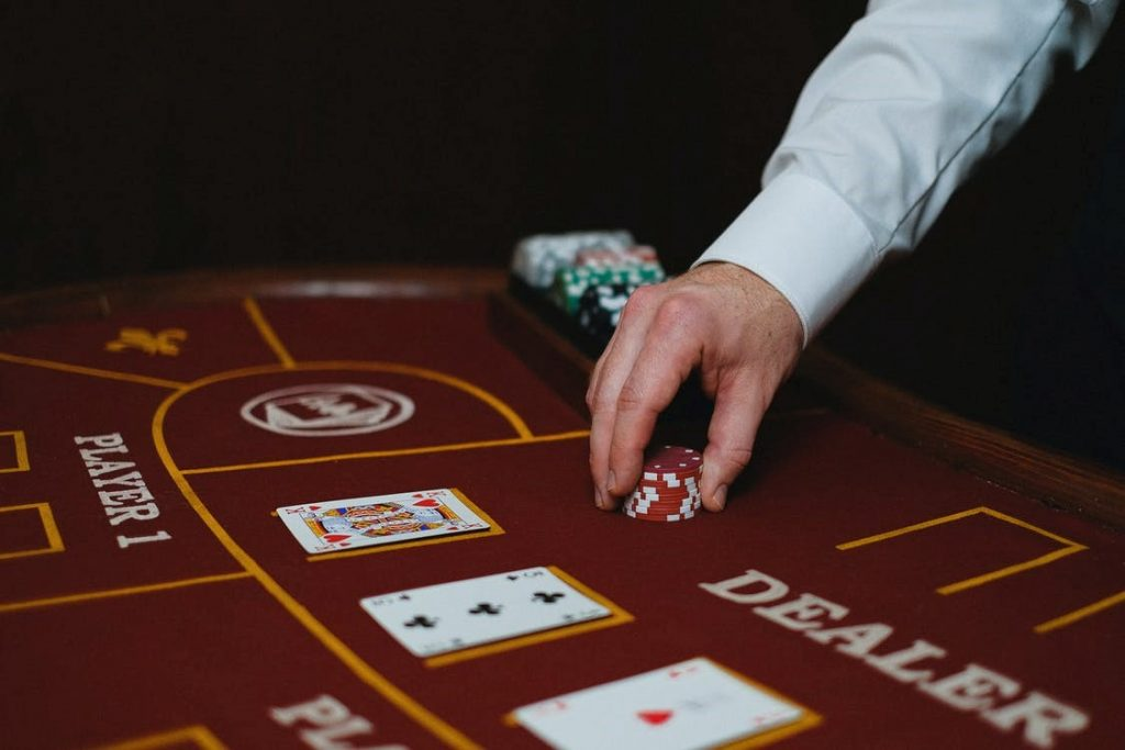 Blackjack dealer dealing