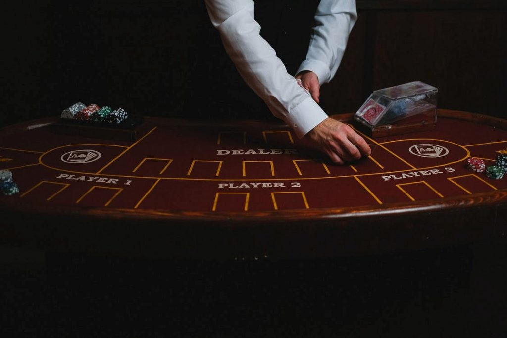 Empty blackjack table with dealer