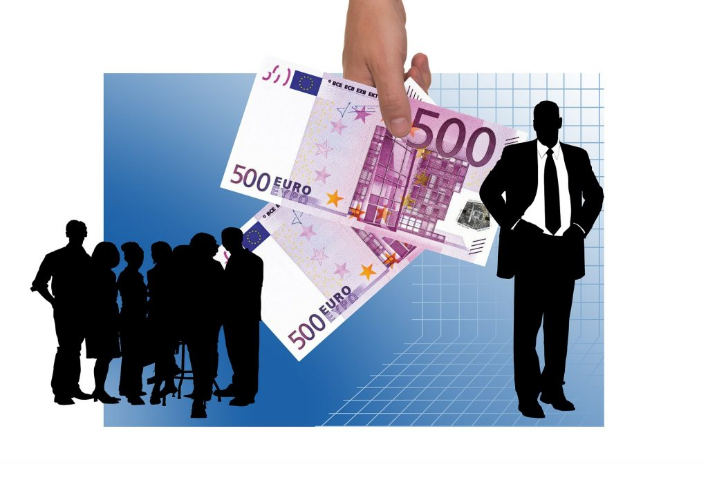 business shadow people and a giant hand holding euros